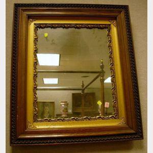 Victorian Gilt Gesso and Walnut Mirror.