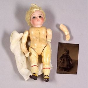 Small Closed Mouth Bisque Head Doll and a Tintype of a Doll