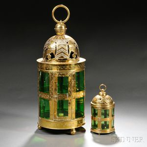 Two Embossed Brass and Green Glass Candle Lanterns
