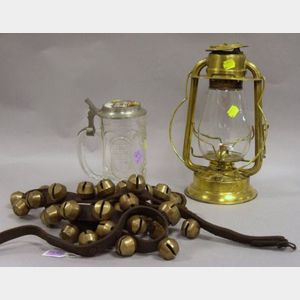 Leather Strap of Forty-two Brass Sleigh Bells, a Hams Gem Gold Blast Brass Kerosene Lantern, and a German Pewter and Handpainted Lind