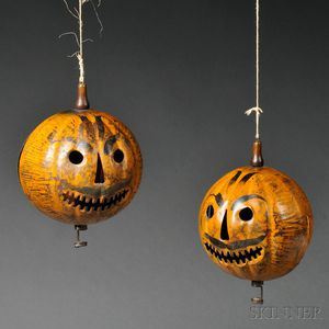 Two Painted Tin Jack-O-Lanterns
