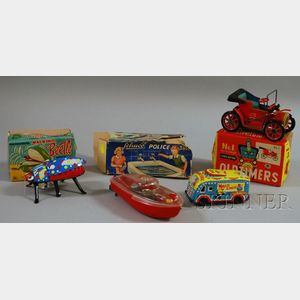 Four Tin and Plastic Toy Vehicles