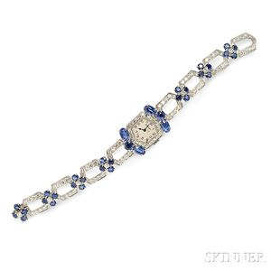 Platinum, Sapphire, and Diamond Wristwatch, Cartier