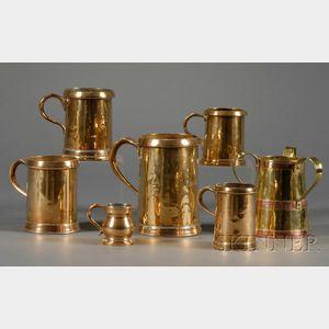 Thirteen English Brass Tankards