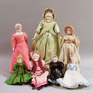 Seven Bisque Bonnet Head Dolls