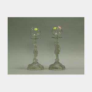 Pair of Frosted Pressed Colorless Figural Oil Lamps.