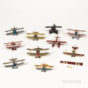Ten Painted and Cast Metal Airplane Toys