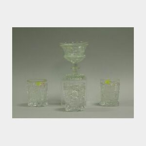 Three Colorless Pattern Glass Tumblers and a Compote