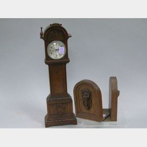 Sessions Miniature Carved Mahogany Tall Clock and a Pair of Carved Mahogany Lion Mask Bookends.