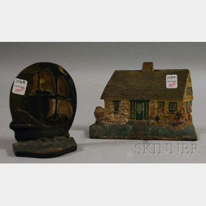 Painted Cast Iron Cape Cottage Doorstop and a Sailing Ship Doorstop