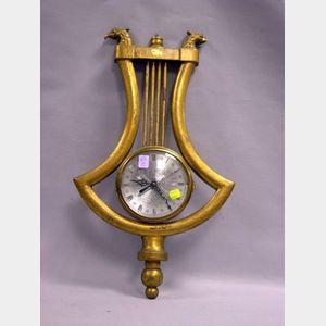 Giltwood Lyre-form Wall Clock.
