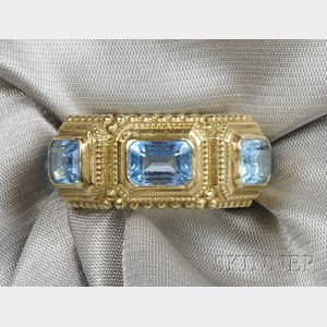 18kt Gold and Blue Topaz Ring