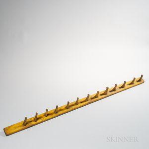 Yellow-painted Peg Rack