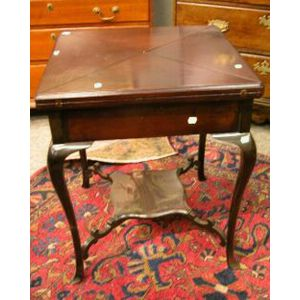 Late Victorian Mahogany Folding-top Games Table.