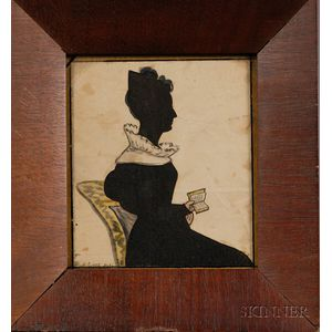 Silhouette of a Woman Sitting Holding a Book