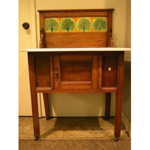 English Arts & Crafts Marble-top Oak Commode with Peacock Tile Backsplash.