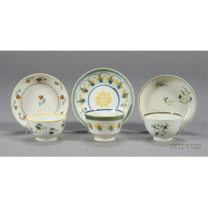 Three Polychrome Decorated Pearlware Tea Bowl and Saucer Sets