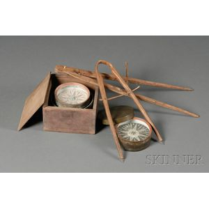 Two Boxed Compasses and Two Carved Wooden Compasses