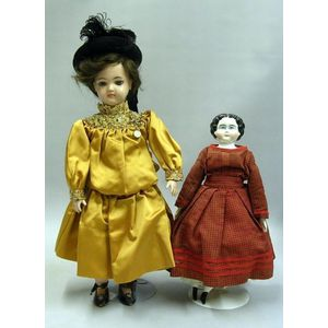 China Doll and a Jointed Metal Girl with Fashionable Accessories