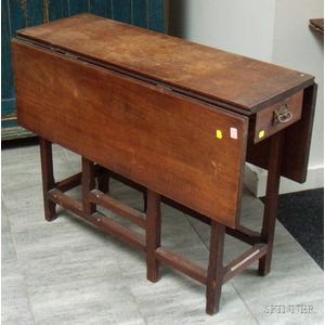 Gothic Revival Oak Drop-leaf Gate-leg Table with End Drawers.