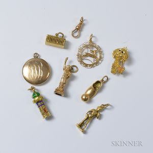 Seven Gold Figural Charms and an 18kt Gold Dog Brooch