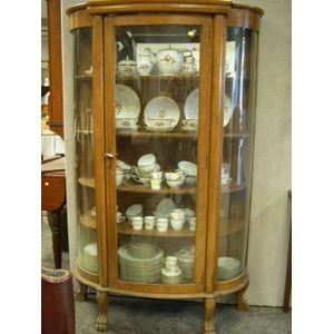 Late Victorian Carved Oak and Curved Glass China Cabinet.