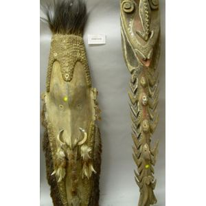 Two Large New Guinea Carved, Painted, and Embellished Wooden Masks and a Carved Wooden Sculpture.