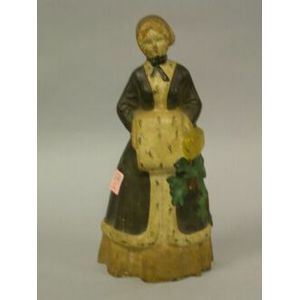 Painted Cast Iron Woman in an Ermine Trimmed Coat and Muff Doorstop