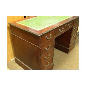 Mahogany Leather Inset Flat-top Double-Pedestal Desk.