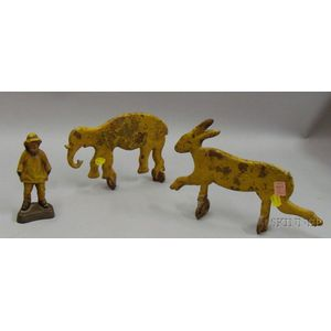 Cast Iron Yellow-painted Figure Wearing a Rain Slicker with Two Animal-form Shooting