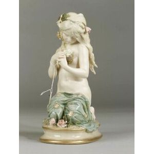 Bohemian Porcelain Figure of a Girl with a Nest of Birds