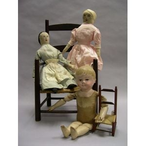 Three Cloth Dolls and Two Chairs