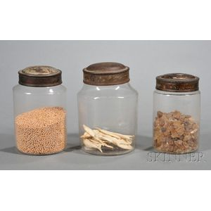 Three Small Blown Colorless Glass Cannisters with Tin Lids