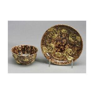 Staffordshire Tortoise Shell Glazed Creamware Tea Bowl and Saucer