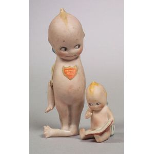 Small Seated Kewpie Reading a Book and Standing Kewpie