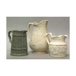 Three English Salt-Glazed Stoneware Pitchers.