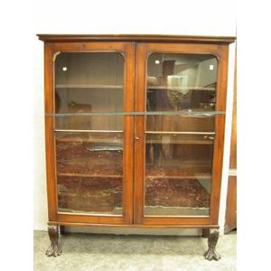 Classical Revival Glazed Carved Mahogany Two-Door Book Cabinet.