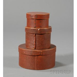 Three Small Round Red-painted Lapped-seam Covered Boxes