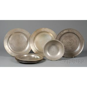Seven Large Pewter Plates and a Basin