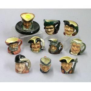 Nine Miniature Royal Doulton Jugs and a Match Stand/Ashtray