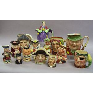 Thirteen Assorted English Ceramic Character Jugs and a Teapot