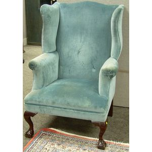 Georgian-style Upholstered Carved Beechwood Wing Chair.