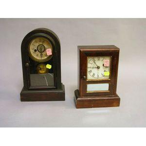 Seth Thomas Rosewood Veneer Cottage Shelf Clock and a Waterbury Clock Co. Rosewood   Grained Cottage Shelf Clock