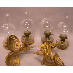 Near Pair of Bradley & Hubbard Victorian Aesthetic Gilt Cast Metal Two-Light Kerosene Wall Sconces.