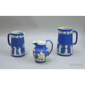 Three Wedgwood Dark Blue Pitchers