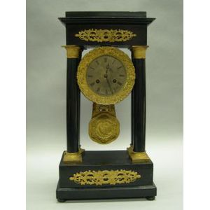 Charles X Ormolu Mounted Black Lacquered Portico Clock.