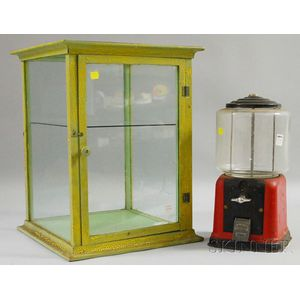 Vintage 5-cent Coin-op Countertop Gumball Machine and a Green over Yellow-painted   Wood and Glass Countertop Display Cabinet