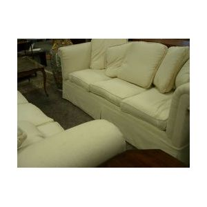 Pair of Ecru Cotton Upholstered Down-filled Sofas.