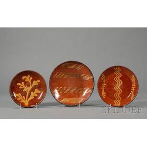 Three Redware Slip-decorated Plates