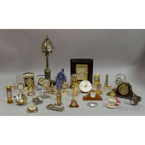 Collection of Approximately Twenty-five Miniature Quartz Timepieces of Varying Designs.